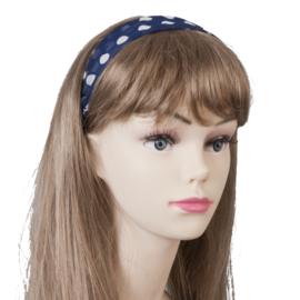 Mooie donkerblauwe haarband met witte bolletjes. (polka dot)