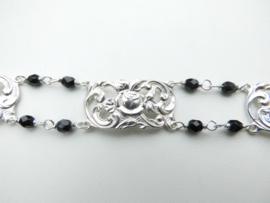 Zilveren zwarte kralen witte lotus bracelet.