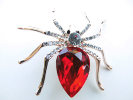 Broche spin met rode steen