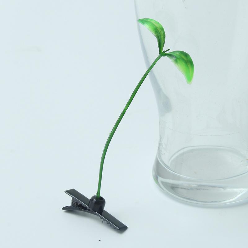 """Grappige """" hé, er groeit een grassprietje uit je hoofd """" haarklem. ( 1 stuk )"""