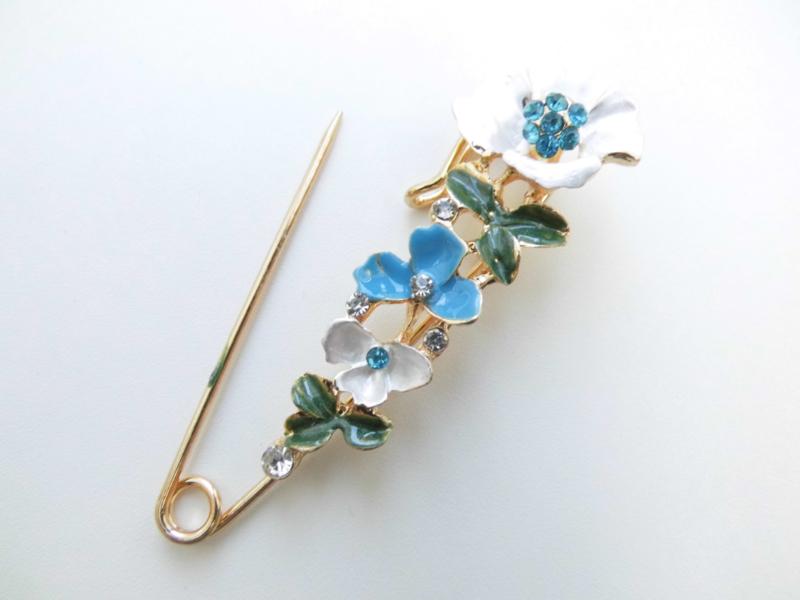 Sjaalspeld blauwe bloemen.