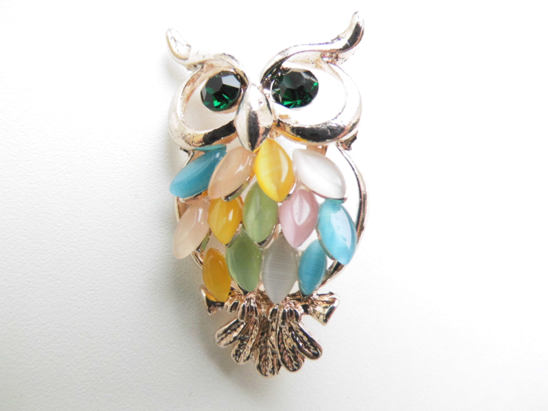 Uil broche