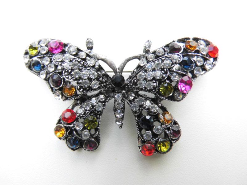 Broche kleurige vlinder.