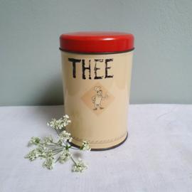"""Oud blikje met bakkertje en opschrift """" Thee"""""""