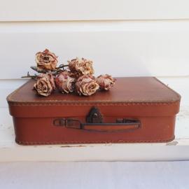 Klein, bruin koffertje