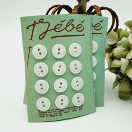 Oude knoopjes op groen kaartje