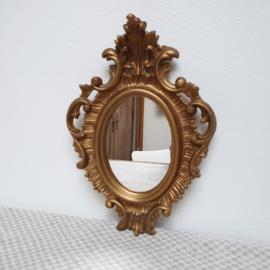 Sierlijk goud spiegeltje