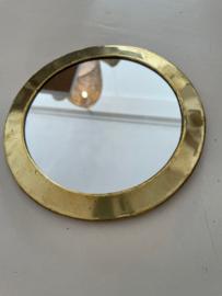 Spiegeltje rond goud
