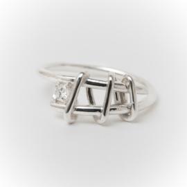 Zilveren wikkelring met diamant