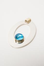 Zilveren met geelgouden hanger met blauwe topaas