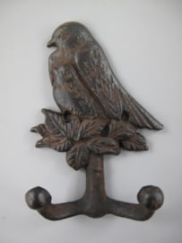 Wandhaak rustiek bruin vogel