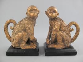 Boekensteun aap goud