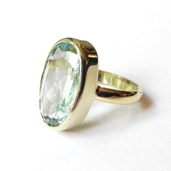 Gouden ring met facetgeslepen aquamarijn