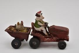 Tractor met dieren en aanhanger rood