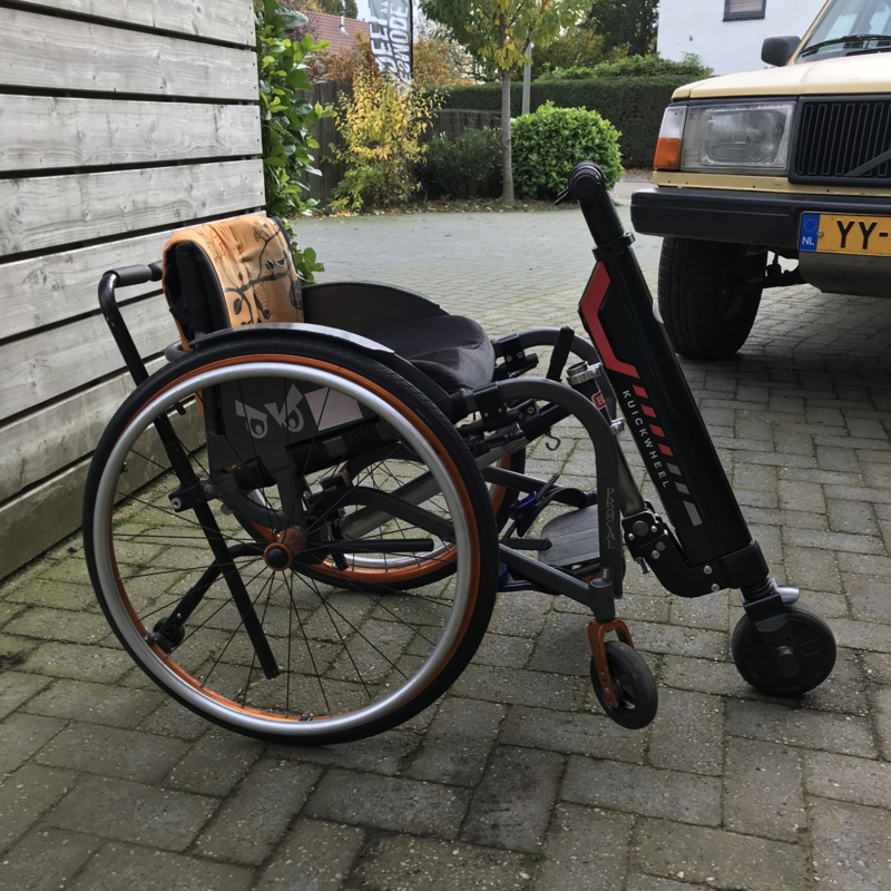 Mounting system for electric scooter on wheelchair