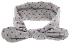 Haarband grijs met roze stippen.