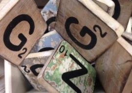 Houten scrabble letter G