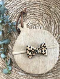 Stoere haarband met een leren leopard strik.