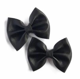 Prachtige leren haarstrikjes in het zwart.