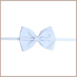 Prachtige leren haarband met grote strik in het wit.