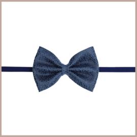 Prachtig  haarband met een leren donkerblauwe strik.