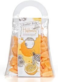 Zuster Evie hakhoning sinaasappel