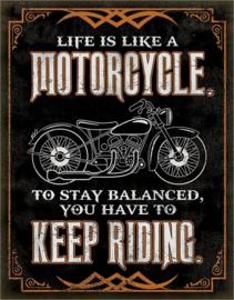 Life is like a Motorcycle .  Metalen wandbord 31,5 x 40,5 cm.