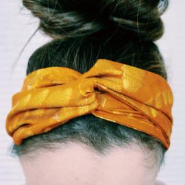 Okergele haarband van Afrikaanse stof