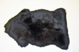 Gekleurde schapenvacht zwart.