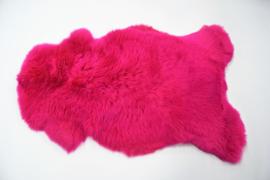 Gekleurde schapenvacht roze.