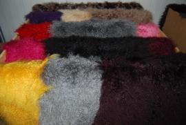 Tibetlamhuiden in diverse kleuren.