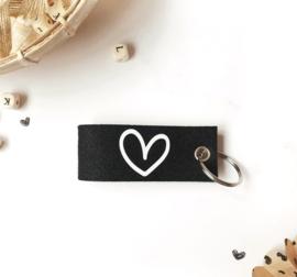 Sleutelhanger || zwart || hart || per stuk