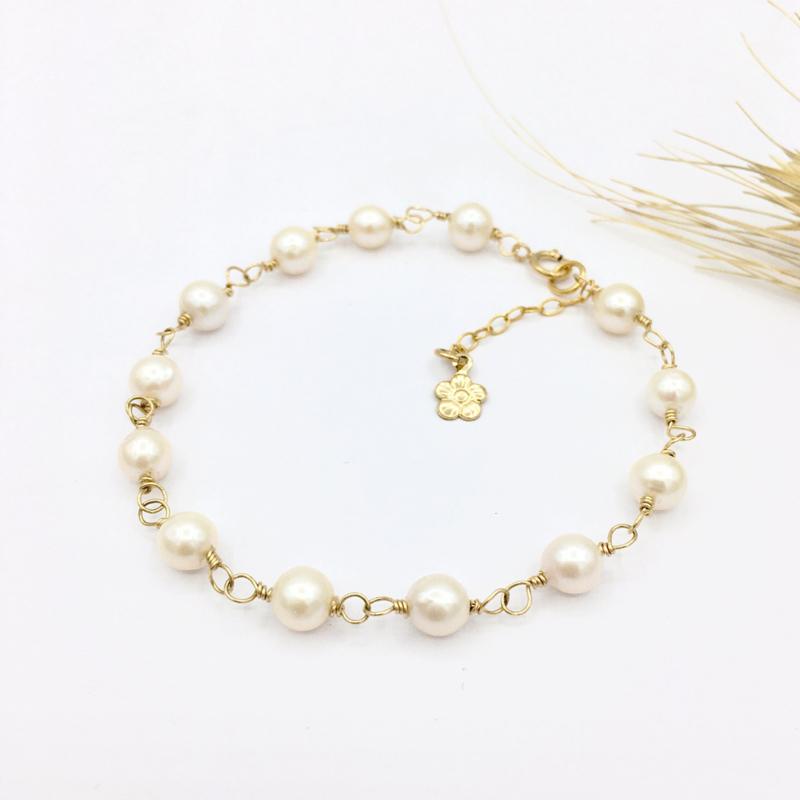Dainty parel armband met kleine parels en goud
