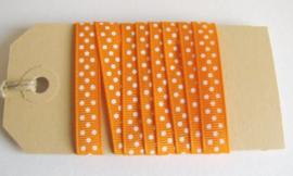 Oranje met witte stippen