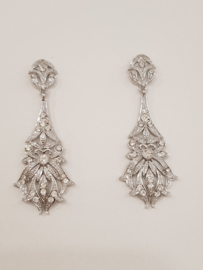 Beautiful long silver colored statement earrings