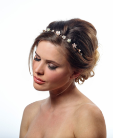 Tiara Margriet: fine metal flowers with hearts of crystal or pearl.