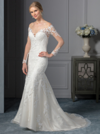 Carolina: Dress with long illusion sleeves made from the finest lace. Decorative Lace applications on the back. Price: € 1.335