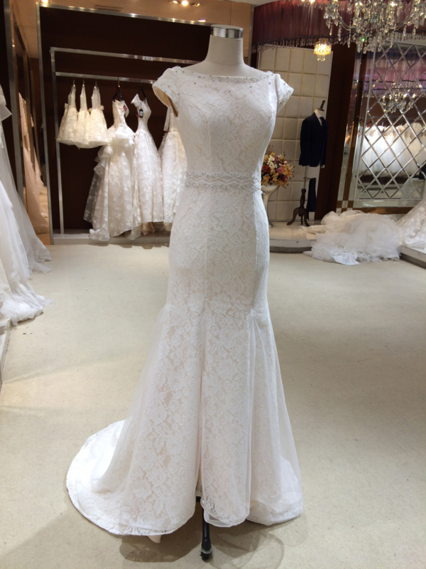Rose: Classical lace wedding dress with beautiful boat neck and short cap sleeves, both finished with beautiful beads. Price: € 695