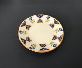 Mini porseleinen bordje met bloemetjes