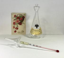 Karafje van glas met wijn thermometer thermomètre à vin