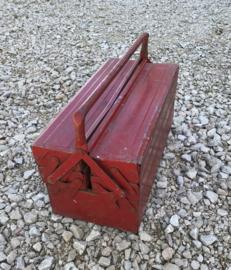 Vintage rode uitklapbare metalen gereedschapskist
