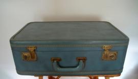 Vintage blauwe koffer