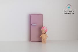 Old pink refrigerator