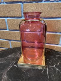 Roze glazen vaas met gouden houder