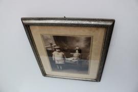 Brocante zilverkleurige lijst met oude foto