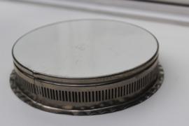 Antieke kleine ronde onderzetter met tegel kersen