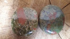 Unakiet platte steen