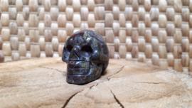 Draken steen of bastiet human skull