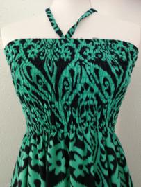 Strapless jurkje 'Green Art'. Gesmockt bovenlijfje, met halterbandje, zijsplitje, lengte 106 cm  vanaf bovenkant smockrand. Bovenwijdte rekbaar tot 100 cm. One size  size voor maat 36 t/m 42.  100% rayon.