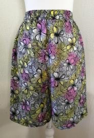 Collectors item van eigen label. Vrolijk Frangipani broekrokje. Met elastische taille. Lengte vanaf de taille 54 cm. Taille 68 cm.  maat 36/38. 100% rayon.